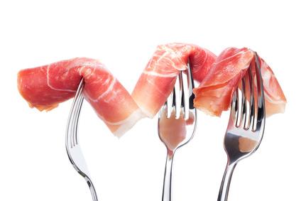 Spanish jamon on forks isolated